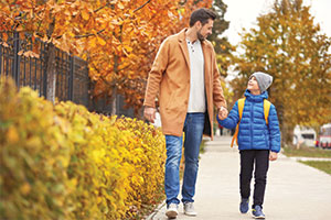 Father and Child Walking in Autumn